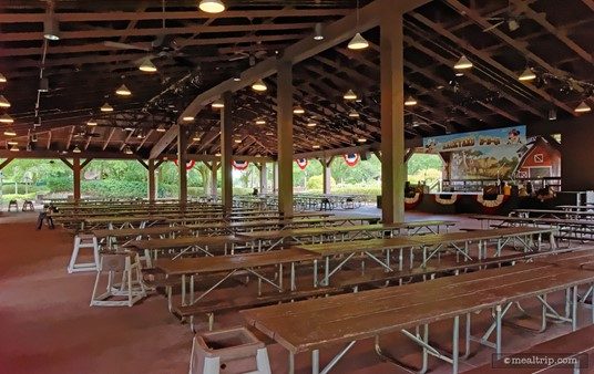 Seating for  Mickey's Backyard BBQ is on long bench-style tables and under one giant pavilion. As you can see, highchairs are also available.