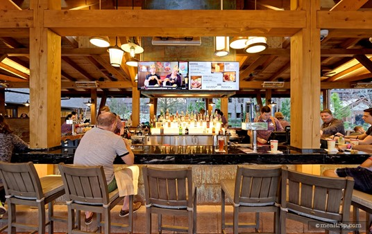 """The actual """"bar"""" at the Geyser Point Bar and Grill has """"high-chair"""" type of seating on three sides (and even a lower table at one end to accommodate a party with a wheelchair)."""