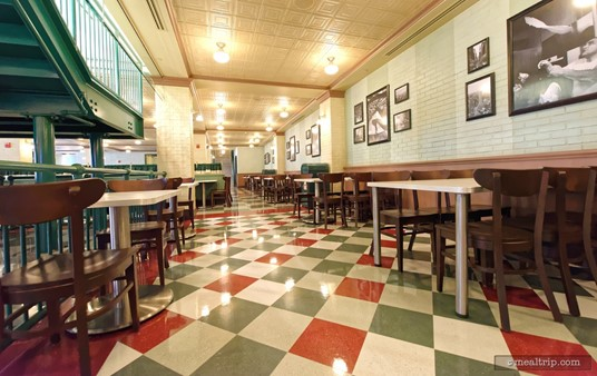 The indoor seating areas at PizzeRizzo are all very well designed. The area on the ground level, near the stairs kind of reminds me of a deli. There are black and white period photos hanging on the white wahsed brick wall.