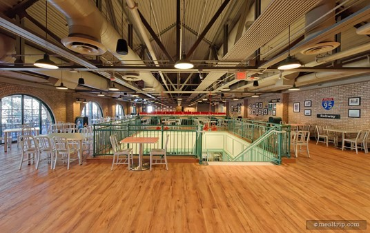 After going up stairs, the decor at PizzeRizzo changes. Note the wood floors throughout most of this area and the open rafters.