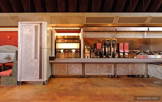 """There are two main """"walls"""" where you will find beverage dispensers, napkins, and silverware along with a few condiments such as tobasco, ketchup and sugar."""