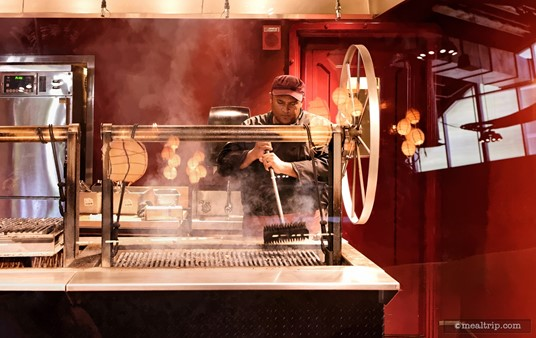 """There are grilled meats, even for breakfast, and the """"red"""" room is where all of the grilling happens. This is a large double sided """"Santa Maria"""" style grill where the grill grate can be raised or lowered by the giant wheel on the right."""