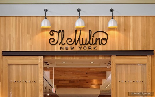 """The Il Mulino sign is above the """"barn door"""" entry."""