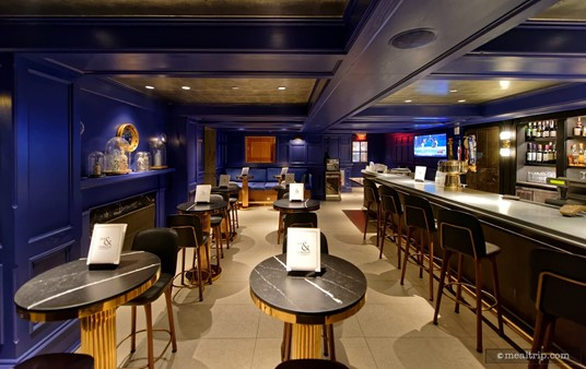 The seating near the bar is mostly highboy style tables and chairs — but there is one booth way in the background!