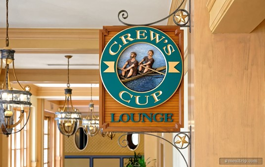 The Crew Cup Lounge sign is hanging quite high up in the hallway, but is directly above the entrance to the lounge. This is a really detailed piece of wood carving art!