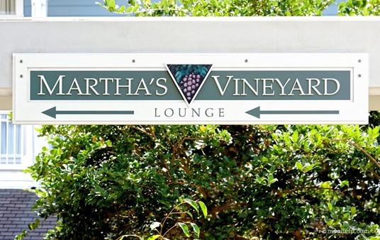 """There seem to be quite a few signs for Martha's Vineyard. This one is just outside the lounge, leading from the """"pool"""" area."""