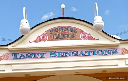 The Tasty Sensations Funnel Cake sign.