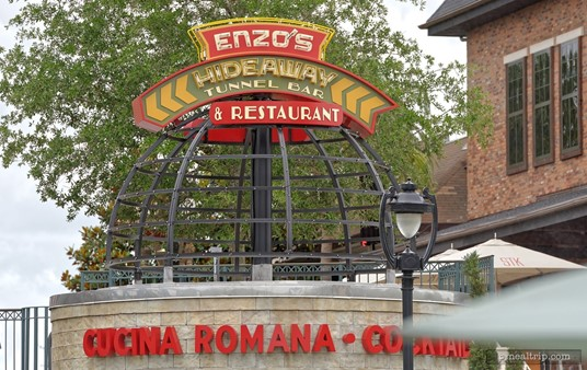 This photo of the Enzo's Hideaway Tunnel Bar & Restaurant sign was taken a good distance from the location. The entrance is just below the sign.