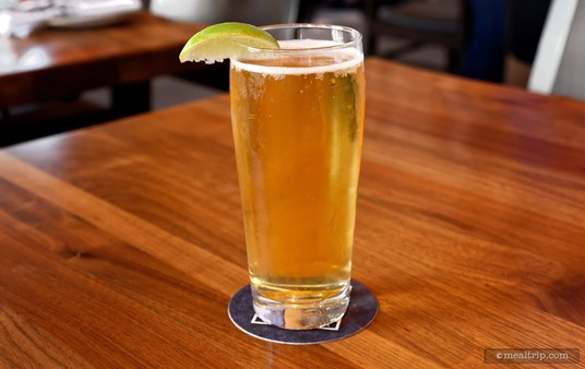 Frontera Cocina has several beer varieties on tap. (This is a Corona Light with a Lime).