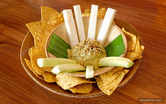 One of my favorite things at Fontera Cocina is this Toasted Pumpkin Seed Hummus! There are fresh chips around the outer bowl with cucumber and jicama spears on the inner bowl.