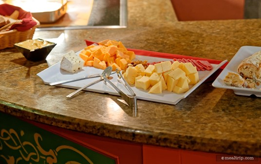 A cheese plate separates the cold and hot stations at Epcot's the Biergarten Restaurant.