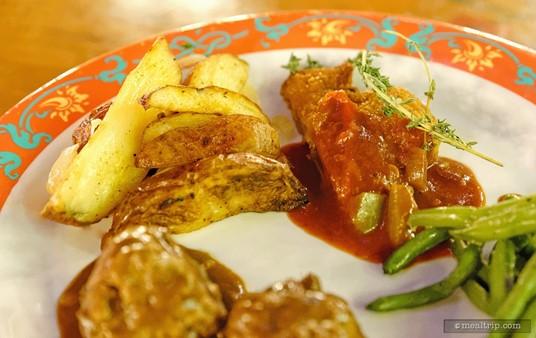 Roasted potatoes and chicken schnitzel from Biergarten.