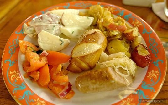 Biergarten's pretzel bread, German potato salad, tomato and onion salad, sausage and sauerkraut.