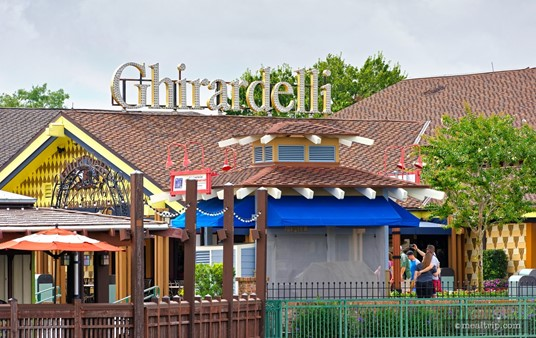 The Ghirardelli® Ice Cream & Chocolate Shop exterior, as seen from across the Disney Springs lake.