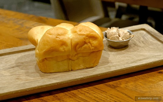 """There is a """"bread service"""" of sorts with dinner. These are essentially parker house rolls with some compound whipped butter. The butter had a bit of cinnamon and some sweetener in it."""