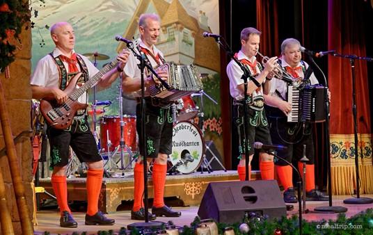 Oktoberfest Musikanten perform during dinner at Epcot's Biergarten Restaurant.