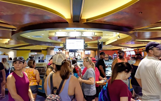 The food ordering and pickup area at Dragon Fire Grill can get quite busy at peak dining times.