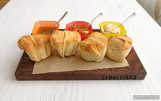 The                  Caribbean Pull-apart Rolls with Guava Butter, Onion Jam, and Jamaican Jerk Oil are served with four rolls for $12 (2019).