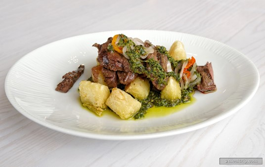 This is the                  Grilled Skirt Steak served with Crispy Yuca, Baby Bell Peppers, and Chimichurri.
