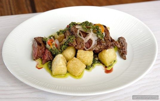 The                  Grilled Skirt Steak served with Crispy Yuca, Baby Bell Peppers, and Chimichurri is on the menu at $28.00 (2019).