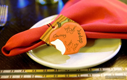 Each place setting includes a pre-printed card with each of the character's signatures - which also serves as a napkin ring.