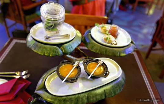 The trio of appetizers at Storybook Dining. Each guest at the table gets one shrimp, one chicken stuffed pastry nugget, and one min-bowl of soup.