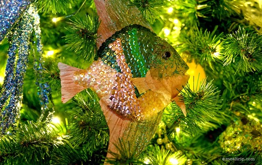 If you visit the Coral Reef Restaurant during the holidays, you may spot a few of these great looking custom made holiday ornaments on the trees in the lobby area.