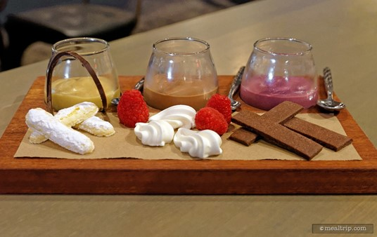 """The """"Trio of Pudding"""" is presented like a wine flight, each pudding is  served in it's own glass, one little spoon per glass, and there's three  pairings to go with each pudding."""