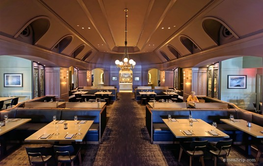 The main dining area is in the very center of the Ale and Compass Restaurant, and mostly consists of half booth, half chair type of tables.