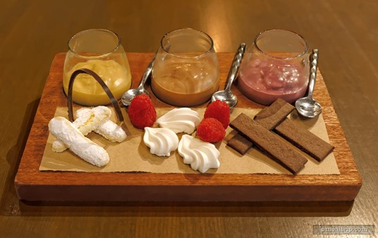 """The Trio of Puddings from the Ale and Compass dinner menu includes """"pairings"""" for each pudding — lady fingers, baked meringue, and chocolate wafers. The pussings from left to  right, Butterscotch, Chocolate, and Blackberry Pudding."""