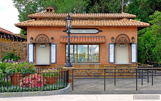"""The Gelateria Toscana shop is located between the American and Italian Pavilions at Epcot. The building and immediate surrounding area has a slightly modern countryside feel — as opposed to the  central courtyard area in the Italy Pavilion, which features more of an old world """"classic"""" Italian theme."""