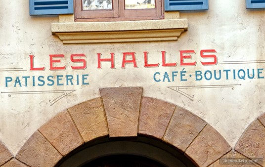 Exterior sign above the entrance to Les Halles Patisserie in the back of Epcot's France pavilion.