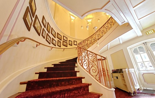 The staircase leading to Monsieur Paul, which is located on the second floor, above Chefs de France at Epcot.