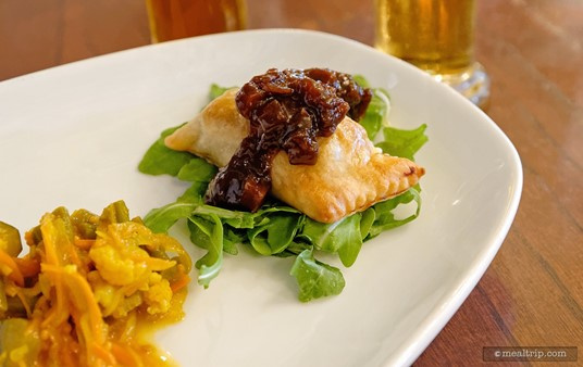 A close-up of the Braised Lamb Pasty topped with Branston Pickles, from  the House-made English Meat Pies Appetizer at the Rose and Crown.