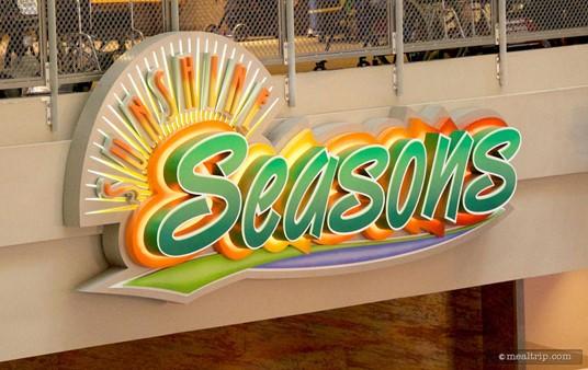 Sunshine Season's main sign as seen from the 'down' escalator.