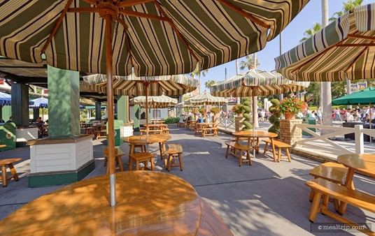 """There is umbrella covered seating close to the """"Sunset Boulevard"""" walkway."""